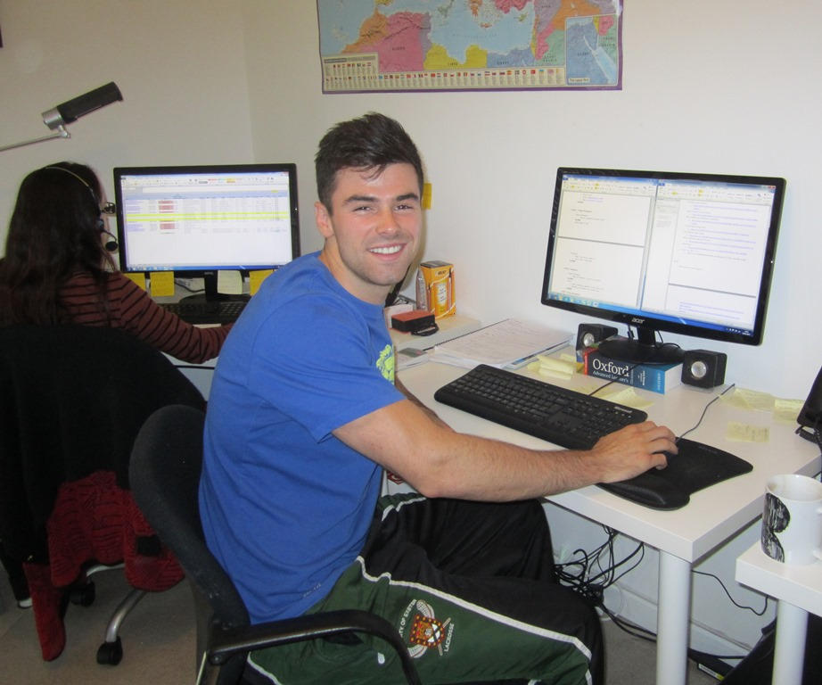 Alex at his desk at Health and Fitness Travel HQ
