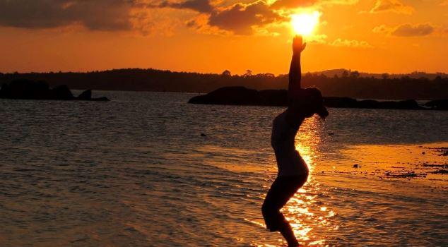 Sunset yoga pose