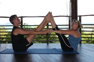 Samantha and Paul practising yoga at Kamalaya, Thailand