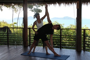 Paul practising yoga with Nok at Kamalaya, Thailand